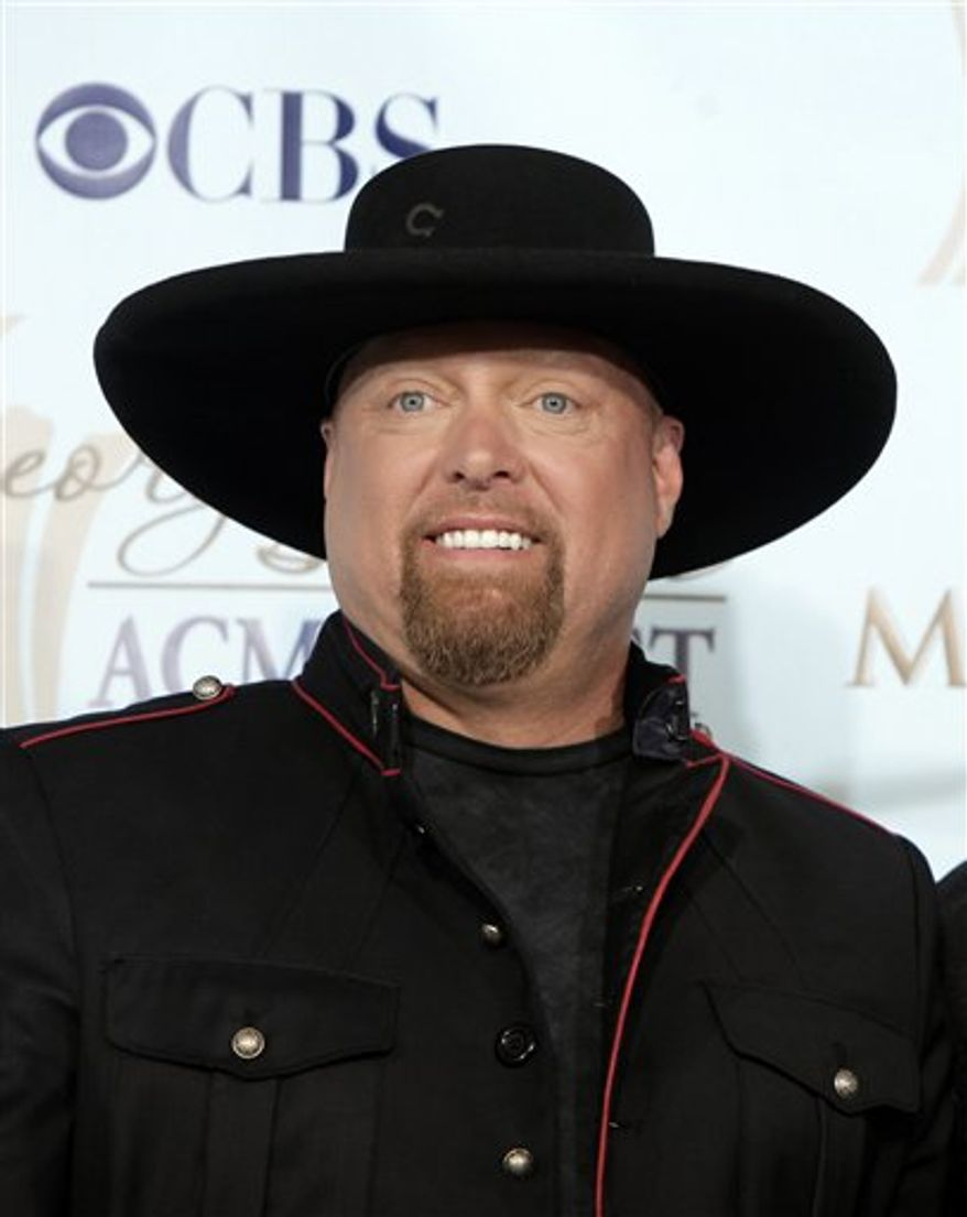 FILE -  In this file photo taken Monday, April 6, 2009, Eddie Montgomery, of Montgomery Gentry, pose backstage at the ACM Artist of the Decade All Star Concert in Las Vegas. (AP Photo/Jae C. Hong, File)