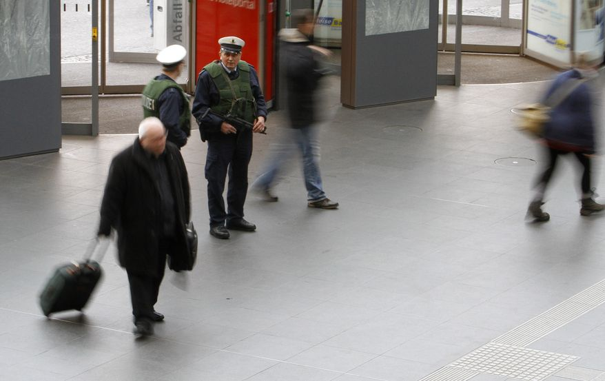 Police equipped with submachine guns and bullet-proof vests guard the main train station in Berlin Friday, Nov. 19, 2010, after German Interior Minister Thomas de Maiziere raised the country's terrorist threat level on Wednesday, saying intelligence services had received a tip from an unspecified country about a suspected attack planned for the end of November. (AP Photo/Ferdinand Ostrop)