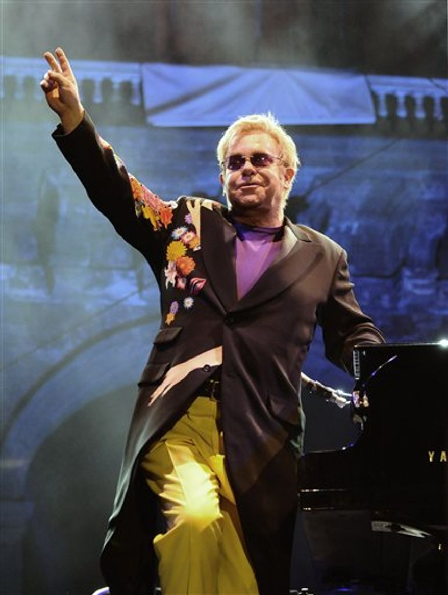 """FILE - In this file photo of Sept. 11 2009 Elton John salutes the audience during his performance at the Piedigrotta festival in Naples. The European Union ordered Italy Friday Nov. 19, 2010 to repay it close to $1 million in EU funds used to stage an Elton John concert. The European Commission says Italy had no right to use EU funds for the 2009 concert in the city of Naples. EU spokesman Ton van Lierop said EU money can be used to promote culture but not if that means staging a one-off rock concert. """"We have asked for our money back,"""" he added.  (AP Photo/Salvatore Laporta)"""