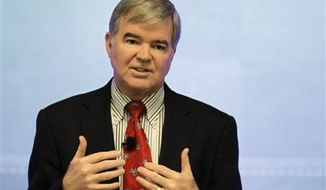 """FILE - This Oct. 7, 2010, file photo shows NCAA President Mark Emmert speaking during the Indiana Sports Corporation annual meeting in Indianapolis. Emmert says he wants investigations such as that of Auburn quarterback Cam Newton to be """"as efficient and expedited"""" as possible but """"you've got to get the facts right."""" At Friday's, Nov. 19, 2010,  taping of a TV show to air Monday on the Big Ten Network, Emmert said the NCAA's """"burden of proof is higher than what it is for somebody who's writing in a blog."""" (AP Photo/Darron Cummings, File)"""