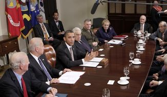 President Barack Obama about the New START pact (Strategic Arms Reduction Treaty), Thursday, Nov. 18, 2010, in the Roosevelt Room at the White House in Washington. Seated from left are: former Secretary of State James A. Baker III, Vice President Joe Biden, Obama, former Secretary of State Henry Kissinger, Joint Chiefs Vice Chairman Marine Gen. James Cartwright, former Secretary of State Madeleine Albright, Former National Security Adviser Brent Scowcroft, and former Defense Secretary William Perry. (AP Photo/J. Scott Applewhite)