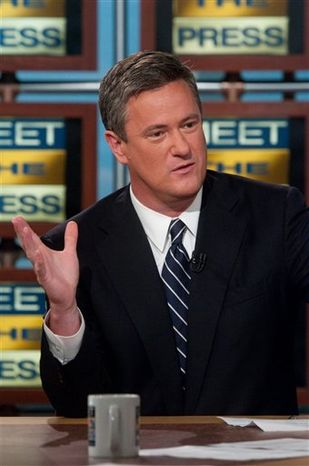 "FILE - In this April 3, 2009 file photo originally released by NBC, Joe Scarborough, host of MSNBC's ""Morning Joe"" right discusses the future of the Republican party on NBC's ""Meet the Press"" in Washington. MSNBC says it's suspending morning host Joe Scarborough for two days without pay for making political contributions.The eight donations, each for $500, violate NBC News policy, MSNBC president Phil Griffin said Friday, Nov. 19, 2010. (AP Photo/NBC, William B. Plowman, file)"