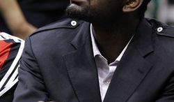 """FILE - In this Oct. 7, 2010, file photo, Portland Trail Blazers Greg Oden sits on the bench during the first half of their NBA preseason basketball game against the Utah Jazz in Salt Lake City. With Oden neeeding another knee operation and missing another season, Portland coach Nate McMillan confronts the """"Curse of the Trail Blazers' Big Men."""" (AP Photo/Colin E Braley, File)"""