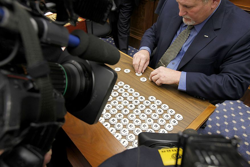 Numbers are prepared on Capitol Hill in Washington, Friday, Nov. 19, 2010, as the incoming House of Representatives members drew in a lottery to pick their office space. (AP Photo/Harry Hamburg)