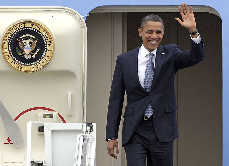 U.S. President Barack Obama waves as he steps off the plane for a NATO summit in Lisbon on Friday, Nov. 19, 2010. U.S. President Barack Obama and the leaders of NATO's 27 other member nations will open a two-day summit Friday aimed at finding ways to keep the Cold War alliance relevant in the 21st century with revamped roles including ballistic missile defense, anti-piracy patrols, and counterterrorism. (AP Photo/Andre Kosters, Pool)