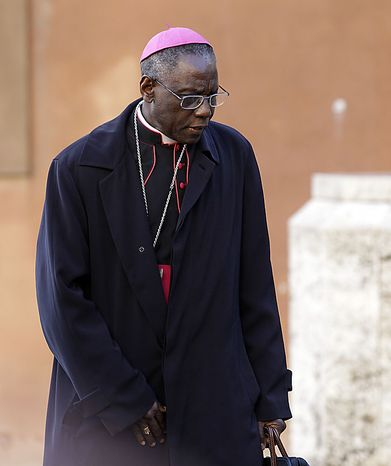 """President of the Pontifical Council """"Cor Unum"""" Archbishop Robert Sarah, of Guinea arrives to attend a meeting of cardinals summoned by Pope Benedict XVI for a day of reflection at the Vatican, Friday, Nov. 19, 2010, the day before a ceremony to create 24 new cardinals including Archbishop Robert Sarah who is scheduled to to elevated to cardinal. The top agenda, religious freedom, grew remarkably timely given China's planned ordination Saturday of a bishop who doesn't have the Pope's approval. The Vatican warned China that efforts at reconciliatio"""