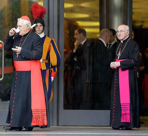 """Cardinal Jose da Cruz Policarpo, of Portugal, left, sips his coffee as Archbishop Gianfranco Ravasi, right, watches during a break in a meeting of cardinals summoned by Pope Benedict XVI for a day of reflection at the Vatican, Friday, Nov. 19, 2010, the day before a ceremony to create 24 new cardinals. The top agenda, religious freedom, grew remarkably timely given China's planned ordination Saturday of a bishop who doesn't have the Pope's approval. The Vatican warned China that efforts at reconciliation would be set back if bishops loyal to the pope were forced to attend the ordination. The Vatican said such actions would constitute """"grave violations of freedom of religion and freedom of conscience.'' Ravasi is one of the 24 prelates that will be elevated to cardinal on Saturday.  (AP Photo/Alessandra Tarantino)"""