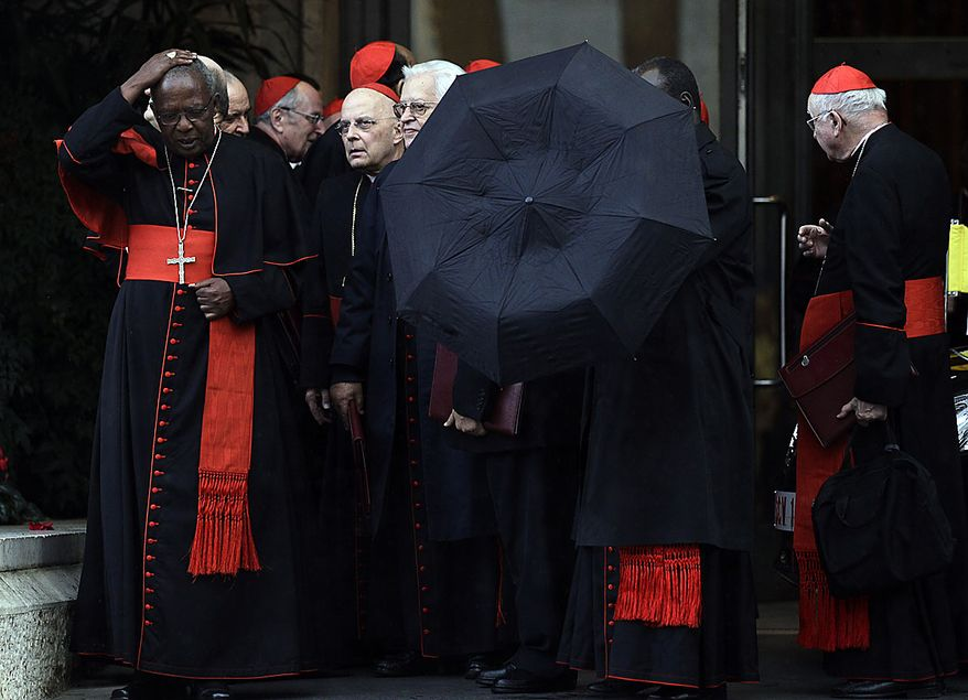 """Cardinals take shelter from the rain as they leave a meeting  for a day of reflection at the Vatican, Friday, Nov. 19, 2010. Pope Benedict XVI summoned cardinals the day before a ceremony to create 24 new cardinals. The top agenda, religious freedom, grew remarkably timely given China's planned ordination Saturday of a bishop who doesn't have the Pope's approval. The Vatican warned China that efforts at reconciliation would be set back if bishops loyal to the pope were forced to attend the ordination. The Vatican said such actions would constitute """"grave violations of freedom of religion and freedom of conscience.'' (AP Photo/Alessandra Tarantino)"""