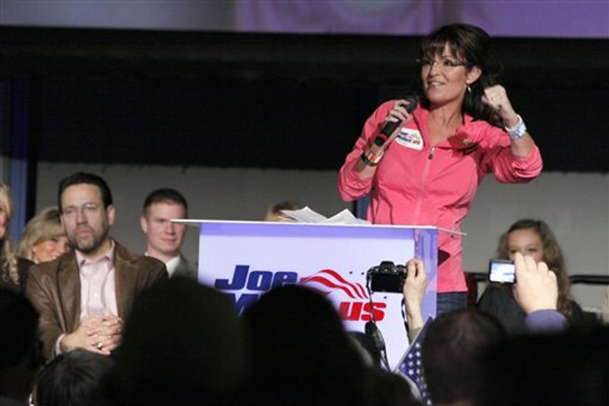 FILE - In this Oct. 28, 2010, file photo, former Alaska Gov. Sarah Palin campaigns for Senate candidate Joe Miller, left in Anchorage, Alaska. Sen. Lisa Murkowski's stunning write-in victory was a political poke in the eye to Alaska's other favorite daughter, Sarah Palin. (AP Photo/Rob Stapleton)