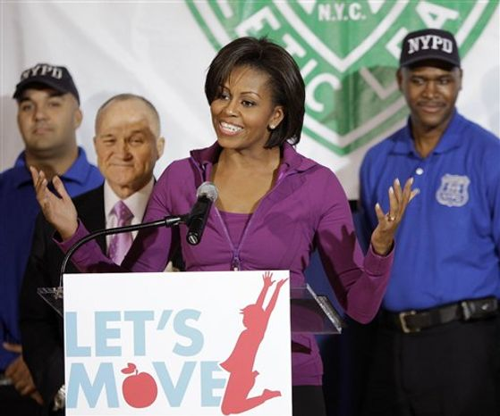 "** FILE ** Joined by New York City Police Chief Raymond Kelly, second from left, first lady Michelle Obama speaks to children while promoting her ""Let's Move!"" exercise initiative at the Police Athletic League Harlem Center in New York, Thursday, Nov. 18, 2010.  (AP Photo/Kathy Willens)"