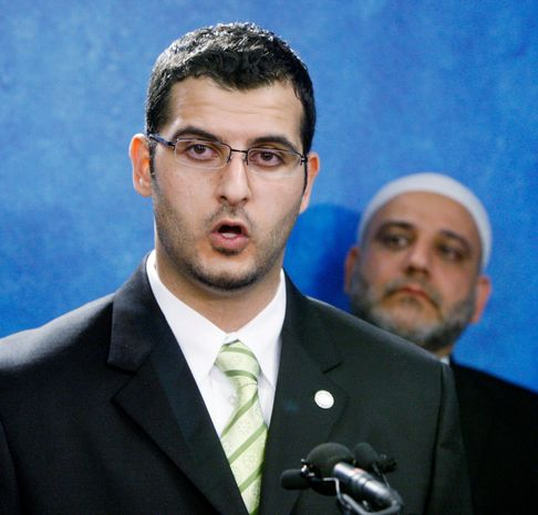 Muneer Awad, Executive Director of the Council on American-Islamic Relations - Oklahoma Chapter, left, answers questions during a news conference concerning a recently passed Oklahoma ballot measure prohibiting state courts from considering international law or Islamic law when deciding cases, in Oklahoma City, Thursday, Nov. 4, 2010. At right is Imad Enchassi, Imam - Islamic Society of Greater Oklahoma City. (AP Photo/Sue Ogrocki)