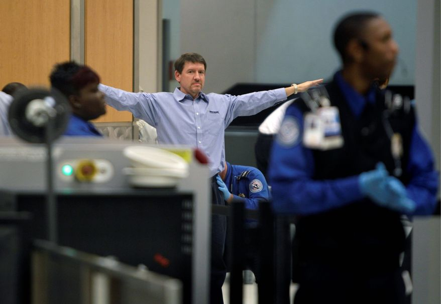ASSOCIATED PRESS A passenger is patted down while going through a security checkpoint at Hartsfield-Jackson Atlanta International Airport in Atlanta.