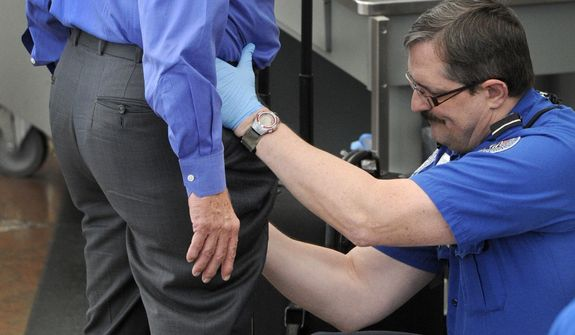 **FILE** In this photo from Nov. 17, a Transportation Security Administration agent performs an enhanced pat-down on a traveler at a security area at Denver International Airport in Denver. The TSA has demonstrated a knack for ignoring the basics of customer relations, while struggling with what experts say is an all but impossible task. (Associated Press/The Denver Post)