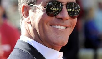 Simon Cowell poses with his award at the 38th International Emmy Awards, Monday, Nov. 22, 2010, in New York. (AP Photo/Louis Lanzano)