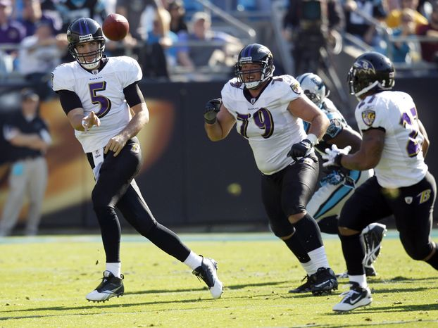ASSOCIATED PRESS Baltimore Ravens quarterback Joe Flacco (5) throws a pass to Ray Rice (27) in the first half of an NFL football game against the Carolina Panthers in Charlotte, N.C., Sunday, Nov. 21, 2010.