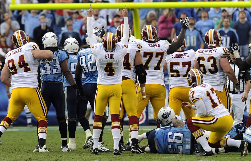 ASSOCIATED PRESS Washington Redskins place kicker Graham Gano (4) celebrates as Redskins and Tennessee Titans players watch his 48-yard field goal go though the goalposts in overtime to give the Redskins a 19-16 win in an NFL football game on Sunday, Nov. 21, 2010, in Nashville, Tenn.
