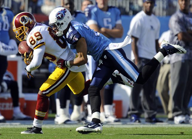 ASSOCIATED PRESS Tennessee Titans cornerback Cortland Finnegan (31) brings down Washington Redskins wide receiver Santana Moss (89) in the second quarter of an NFL football game on Sunday, Nov. 21, 2010, in Nashville, Tenn.