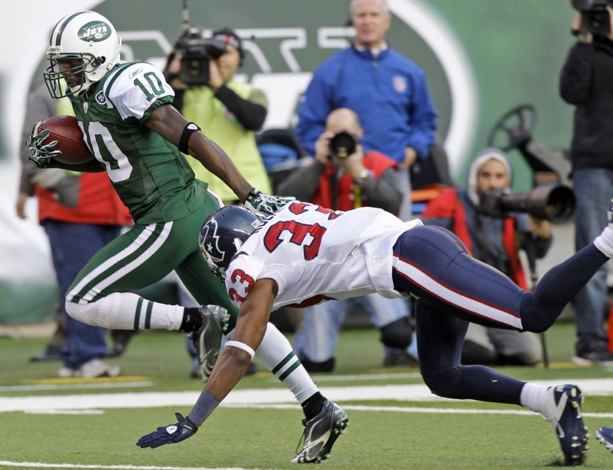 ASSOCIATED PRESS New York Jets wide receiver Santonio Holmes (10) runs away from Houston Texans safety Troy Nolan (33) during the third quarter of an NFL football game at New Meadowlands Stadium Sunday, Nov. 21, 2010, in East Rutherford, N.J.