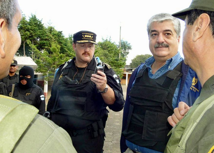 National Police Director Erwin Sperisen stands inside the Pavon prison during a government raid on the outskirts of Guatemala City. (Associated Press)