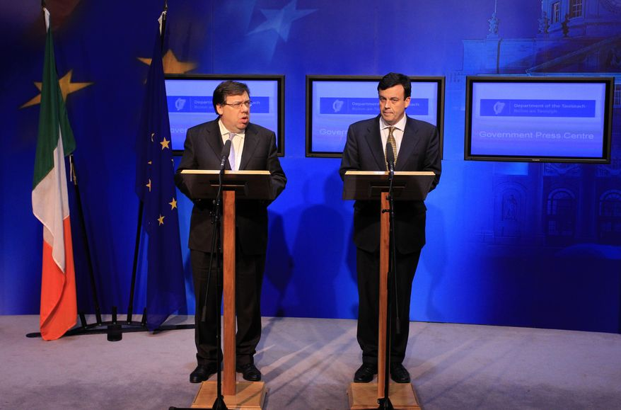 Irish Prime Minister Brian Cowen, left, and Finance Minister Brian Lenihan speak to the media at the government building in Dublin, Ireland, Sunday, Nov. 21, 2010. Debt-crippled Ireland formally applied Sunday for a massive EU-IMF loan to stem the flight of capital from its banks, joining Greece in a step unthinkable only a few years ago when Ireland was a booming Celtic Tiger and the economic envy of Europe. (AP Photo/Peter Morrison)