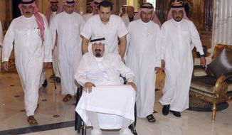 King Abdullah, center, of Saudi Arabia arrives at his palace in Riyadh, Saudi Arabia, Friday, Nov. 19, 2010. The Saudi Press Agency said Abdullah entered a hospital on Friday due to complications in the back pain suffered by them and the doctors advised him to rest. (AP Photo/Saudi Press Agency)