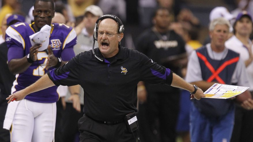 ASSOCIATED PRESS FILE - This Sept. 9, 2010, file photo shows Minnesota Vikings head coach Brad Childress reacting during their NFL football game against the New Orleans Saints at the Louisiana Superdome. The Vikings fired Childress on Monday, Nov. 22, 2010, cutting ties with a head coach who had come under increasing fire from his players - and his boss - for everything from their horrid start to his 1-2 playoff record and his abrupt decisions.