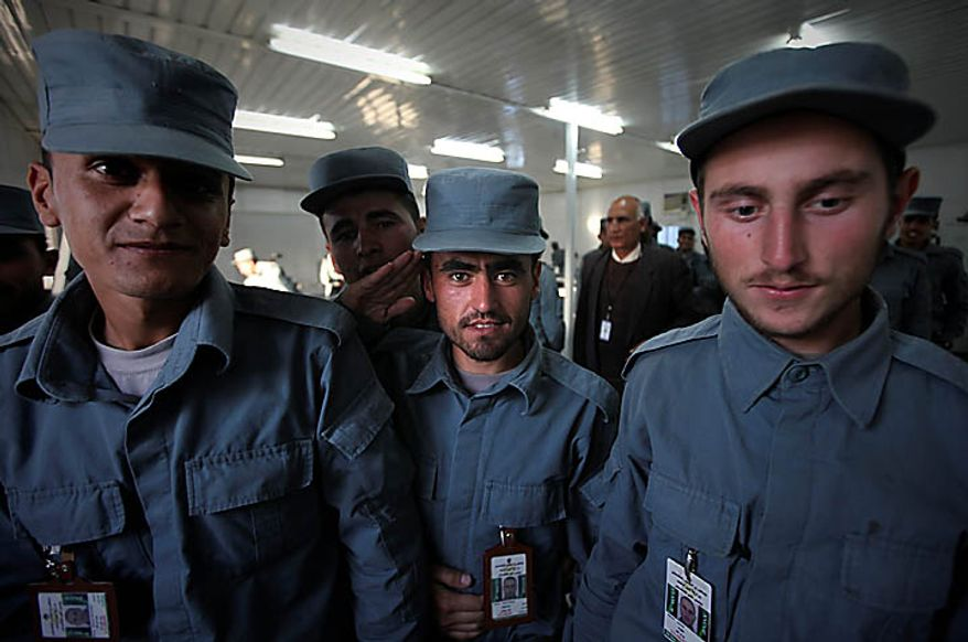 In this photo taken Nov. 7, 2010, new Afghan police recruits leave after attending a literary class at Central Training Center on the outskirts of Kabul, Afghanistan. According to the NATO training mission, only 11 percent of the enlisted personnel in the army and police can read and write, compared to 35 percent for non-commissioned officers and 93 percent for the officer corps. About 74 percent of the population is illiterate, but the percentage in the security forces tends to be higher since fewer educated Afghans are willing to sign up. (AP Photo/Altaf Qadri)