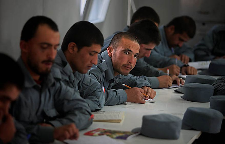 In this Nov. 7, 2010 photo, new Afghan police recruits attend a literary class at Central Training Center on the outskirts of Kabul, Afghanistan. According to the NATO training mission, only 11 percent of the enlisted personnel in the army and police can read and write, compared to 35 percent for non-commissioned officers and 93 for the officer corps. About 74 percent of the population is illiterate, but the percentage in the security forces tends to be higher since fewer educated Afghans are willing to sign up. (AP Photo/Altaf Qadri)