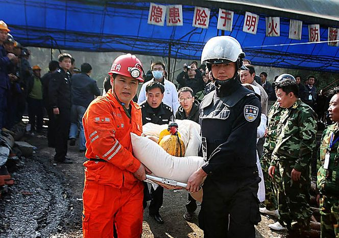 Rescuers and police officers carries a trapped miner on a stretcher out from the flooded Batian Coal Mine in Xiaohe town of Weiyuan county in southwest China's Sichuan province Monday, Nov. 22, 2010. Emergency crews drained the flooded Chinese coal mine and rescued all 29 trapped workers Monday, ending a daylong rescue drama. (AP Photo/Color China Photo)