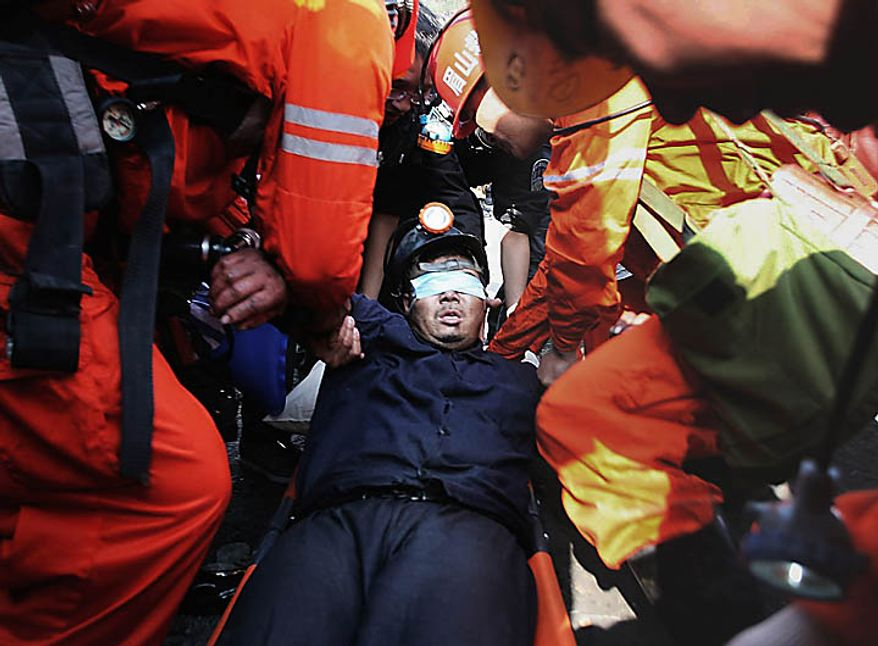 Rescuers put a trapped miner on a stretcher after rescue out from the flooded Batian Coal Mine in Xiaohe town of Weiyuan county in southwest China's Sichuan province Monday, Nov. 22, 2010. Emergency crews drained the flooded Chinese coal mine and rescued all 29 trapped workers Monday, ending a daylong rescue drama. (AP Photo/Color China Photo)