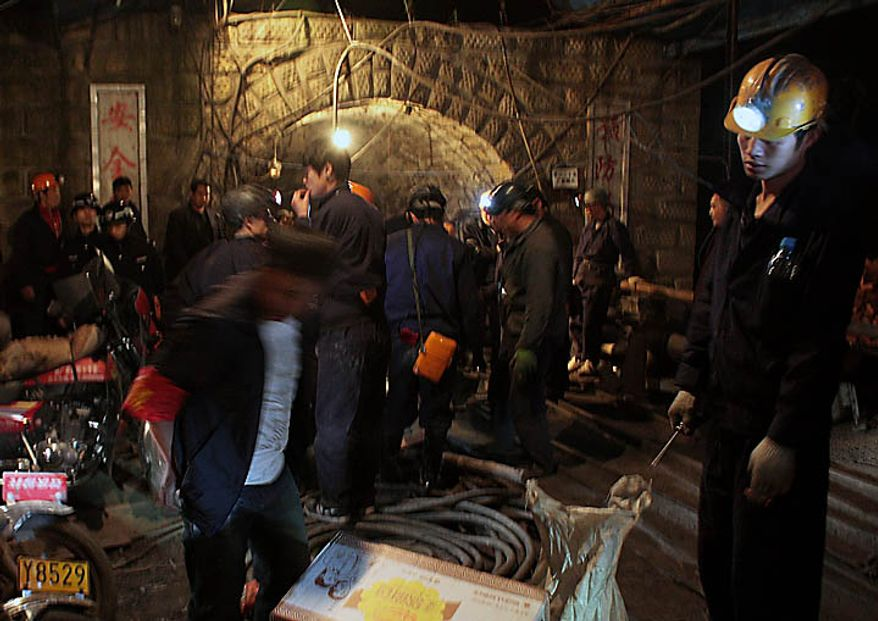 In this Sunday, Nov. 21, 2010 photo, rescuers get ready to enter the flooded Batian Coal Mine in Xiaohe town of Weiyuan county in southwest China's Sichuan province. Rescuers were racing Monday to reach 28 people trapped while doing safety work in coal mine in southern China, the latest accident in the world's deadliest mines.  (AP Photo/Color China Photo)