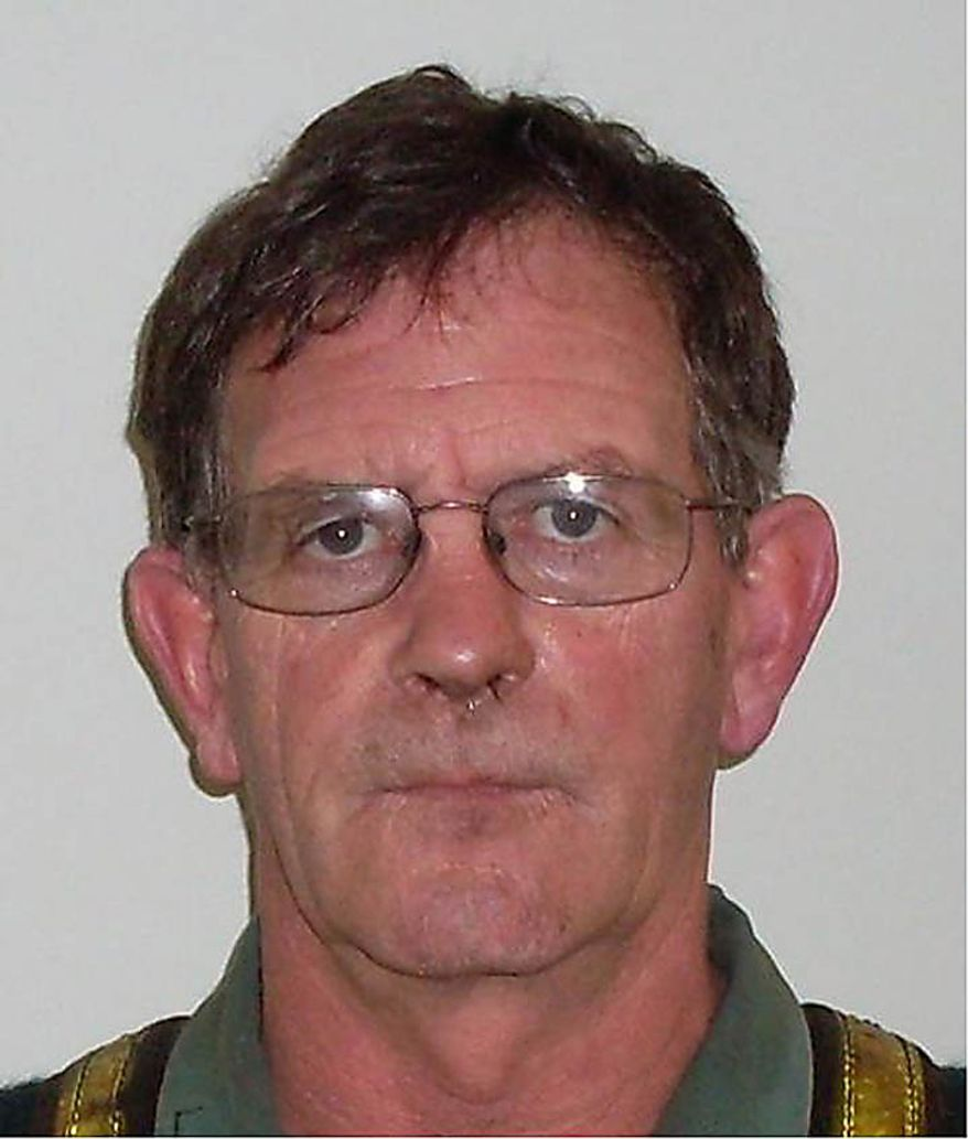 In this undated photo released by New Zealand Police, miner Peter O'Neill, 55, of Rununga, New Zealand, poses before the camera. O'Neill is one of 29 miners believed to be trapped in the Pike River Coal mine near Greymouth, New Zealand, following an explosion at the mine Friday, Nov. 19, 2010. (AP Photo/New Zealand Police)