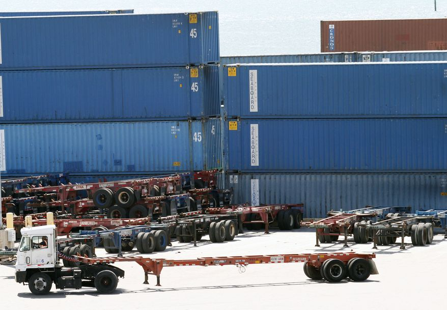 In this Thursday, Oct. 7, 2010 photo, shipping containers are shown stacked at the Port of Miami in Miami. The economy grew slightly faster last summer than first thought, benefiting from stronger spending by U.S. shoppers and improved overseas sales of U.S. goods. (AP Photo/Wilfredo Lee)