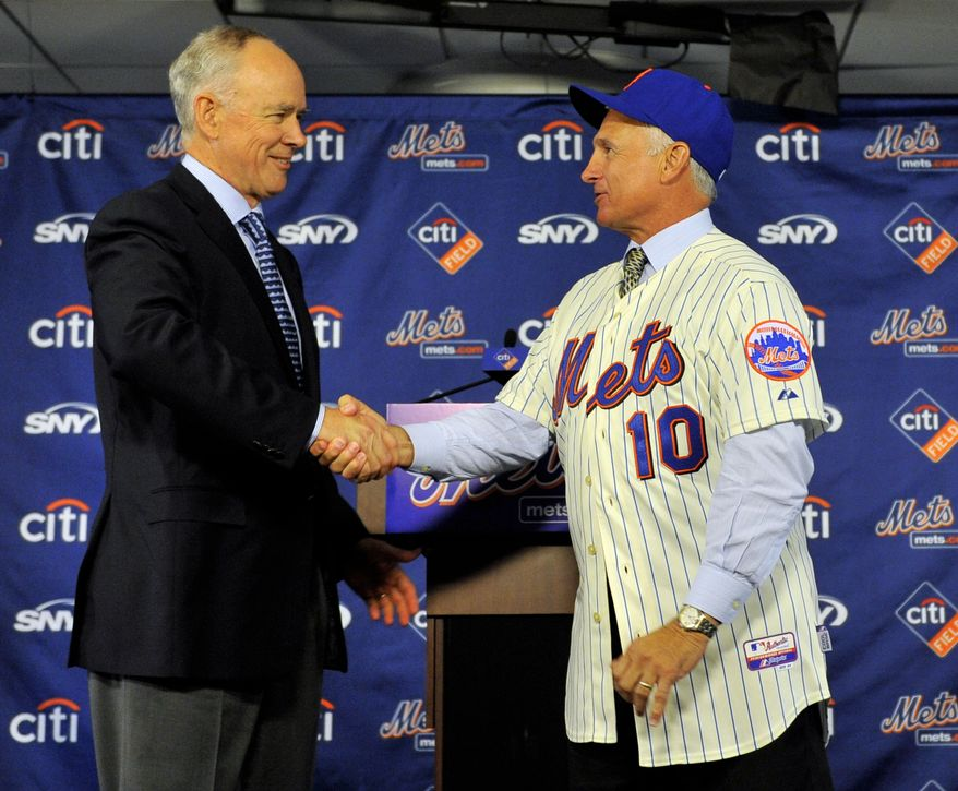 New York Mets General Manager Sandy Alderson, left, shakes hands with newly named Mets manager Terry Collins, during a news conference at Citi Field in New York, Tuesday, Nov. 23, 2010.