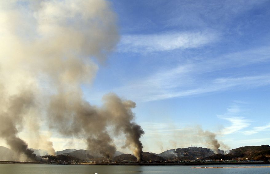 Smoke billow from Yeonpyeong island near the border against North Korea, in South Korea, Tuesday, Nov. 23, 2010. North and South Korea exchanged artillery fire Tuesday after the North shelled an island near their disputed sea border, killing at least two South Korean marines, setting dozens of buildings ablaze and sending civilians fleeing for shelter. (AP Photo/Yonhap)