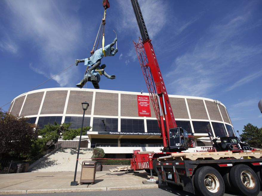 ASSOCIATED PRESS The statue called Score is hoisted to a waiting flatbed outside the Spectrum, Thursday, Oct. 28, 2010, in Philadelphia. The statue depicts Philadelphia Flyers Hall of Famer Gary Dornhoefer's game-winning, overtime goal against the Minnesota North Stars in 1973 Stanley Cup playoffs. After 42 years of hosting events, the Spectrum is slated for demolition.
