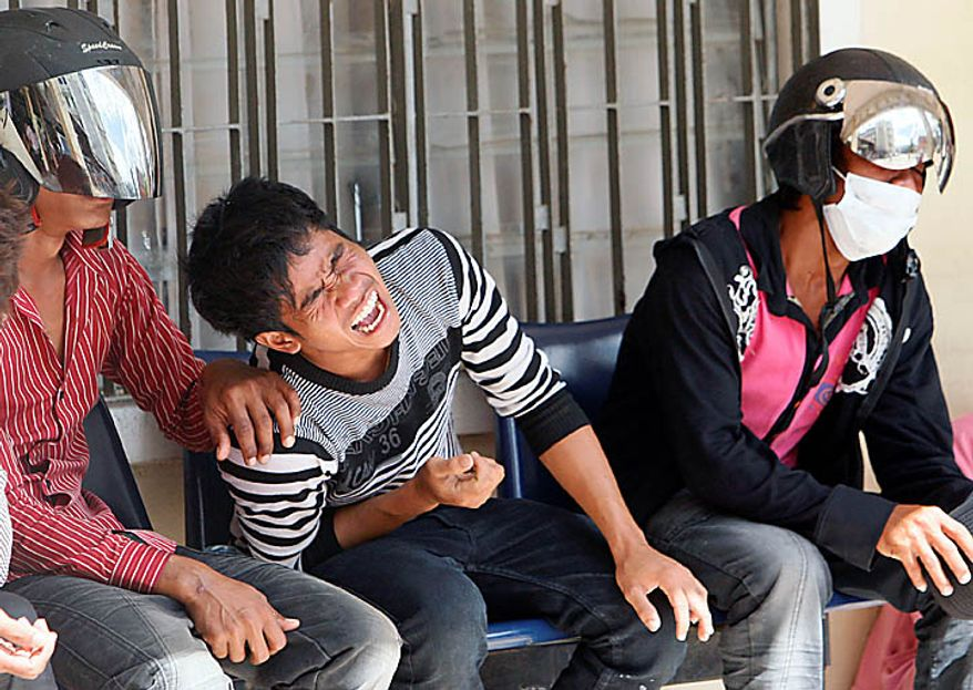 A Cambodian man reacts after his relative was confirmed dead in Monday's stampede, at Preah Kossamak Hospital in Phnom Penh, Cambodia, Tuesday, Nov. 23, 2010. Thousands of people stampeded during a festival in the Cambodian capital, leaving over three hundred dead and scores injured in what Prime Minister Hun Sen called the country's biggest tragedy since the 1970s reign of terror by the Khmer Rouge. (AP Photo/Sakchai Lalit)