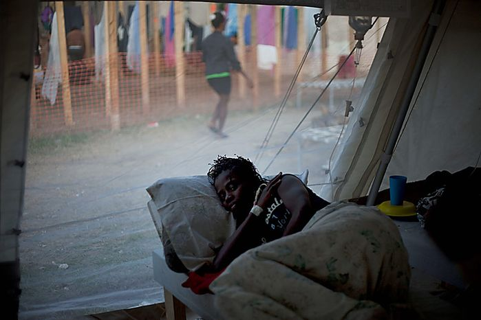 A woman with symptoms of cholera receives treatment at hospital run by Doctors Without Borders in Port-au-Prince, Haiti, Monday, Nov. 22, 2010. Haiti will hold elections on Nov. 28 in the midst of a month-old cholera epidemic that has killed at least 1,000 people and hospitalized thousands. (AP Photo/Ramon Espinosa)