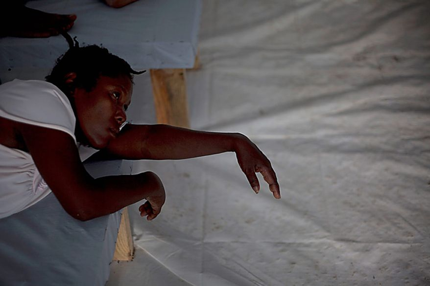A woman with symptoms of cholera receives treatment at a hospital run by Doctors Without Borders in Port-au-Prince, Haiti, Monday, Nov. 22, 2010. Haiti will hold elections on Nov. 28 in the midst of a month-old cholera epidemic that has killed at least 1,000 people and hospitalized thousands. (AP Photo/Ramon Espinosa)