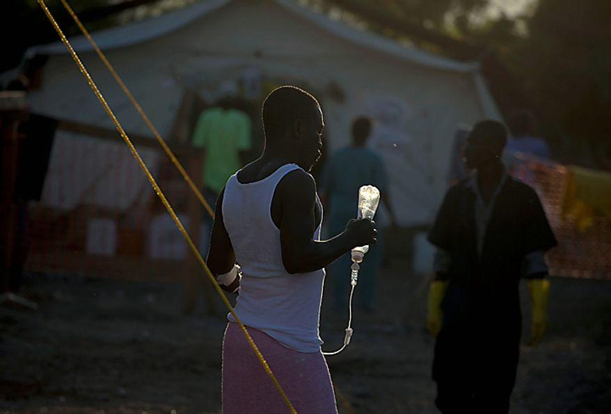 A man with symptoms of cholera receives treatment at a hospital run by Doctors Without Borders in Port-au-Prince, Haiti, Monday, Nov. 22, 2010. Haiti will hold elections on Nov. 28 in the midst of a month-old cholera epidemic that has killed at least 1,000 people and hospitalized thousands. (AP Photo/Ramon Espinosa)