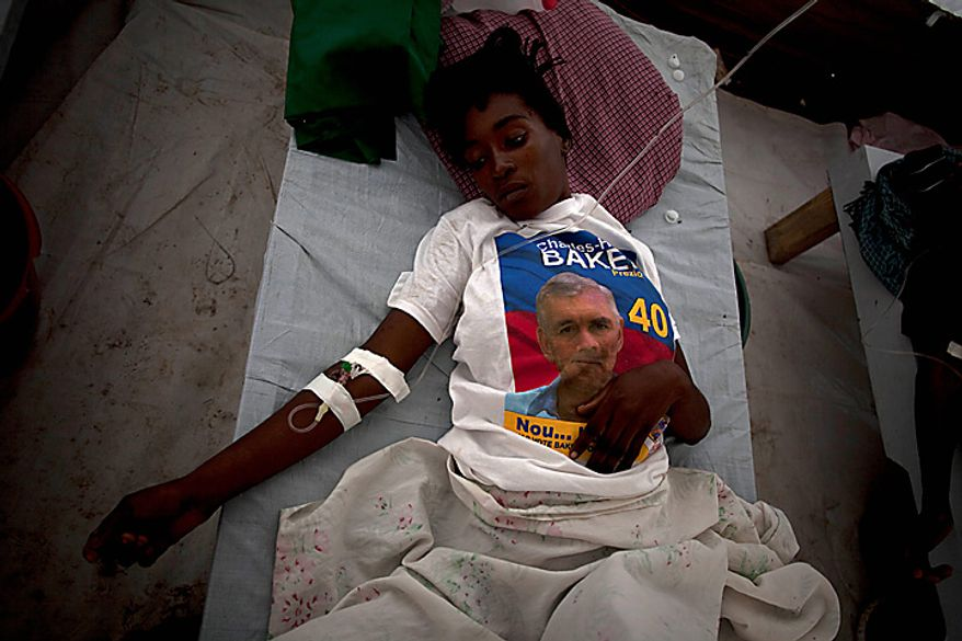 A woman with symptoms of cholera, wearing a T-shirt with a picture of presidential candidate Charles Henry Baker, receives treatment at hospital run by Doctors Without Borders in Port-au-Prince, Haiti, Monday, Nov. 22, 2010. Haiti will hold elections on Nov. 28 in the midst of a month-old cholera epidemic that has killed at least 1,000 people and hospitalized thousands. (AP Photo/Ramon Espinosa)