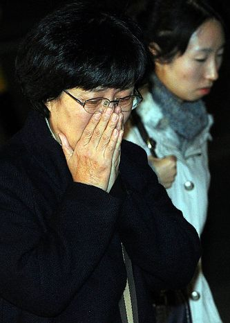Family members of Seo Jeong-woo, a Korean marine who was killed on South Korean Yeonpyeong Island by North Korea's artillery attack, react as they arrive at a military hospital in Seongnam, South Korea, Tuesday, Nov. 23, 2010. North and South Korea exchanged artillery fire Tuesday after the North shelled an island near their disputed sea border, killing at least two South Korean marines, setting dozens of buildings ablaze and sending civilians fleeing for shelter in one the rivals' most dramatic military confrontations since the Korean War.(AP Photo/Yonhap).