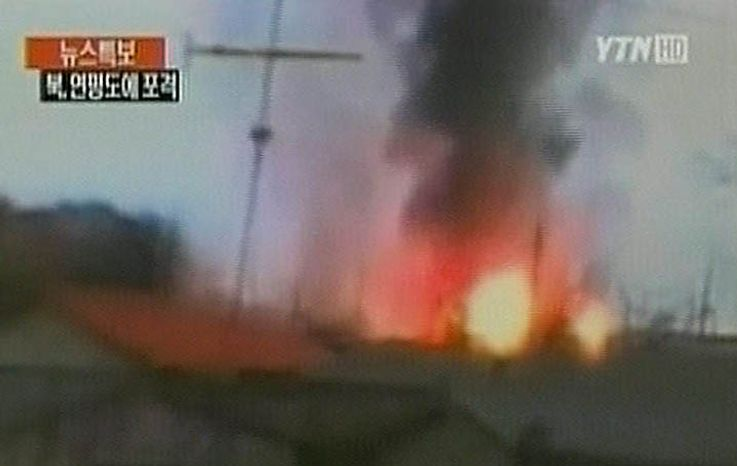 In this image take from TV footage, smoke rises from South Korea's Yeonpyeong island near the border against North Korea, Tuesday, Nov. 23, 2010. North Korea shot dozens of rounds of artillery onto the populated South Korean island near their disputed western border Tuesday, military officials said, setting buildings on fire and prompting South Korea to return fire and scramble fighter jets. (AP Photo/YTN via APTN)