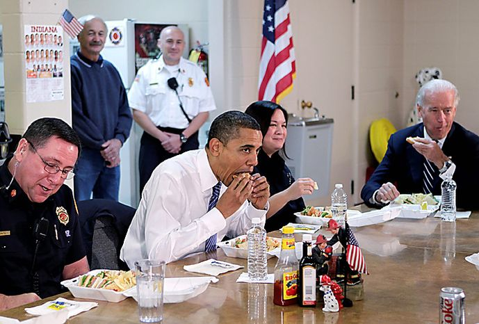 President Barack Obama and Vice President Joe Biden, right, eat lunch during a visit with firefighters in downtown Kokomo, Ind., Tuesday, Nov. 23, 2010.  (AP Photo/J. Scott Applewhite)