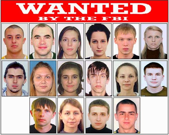 This poster released by the FBI shows photos of individuals wanted by the FBI and shows Eastern European cybercriminals wanted on a variety of federal charges stemming from criminal activities, including money laundering, bank fraud, passport fraud and identity theft in New York. (Associated Press)