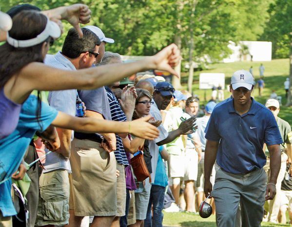 THUMBS DOWN: Tiger Woods, once the crowd favorite of the PGA tour circuit, now must endure disapproval for scandal in his personal life and diminished pro-tournament play. The question: Can he redeem himself? (Associated Press)