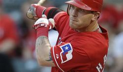FILE - This Aug. 27, 2010, file photo shows Texas Rangers' Josh Hamilton hitting a double agianst the Oakland Athletics' Brett in the first inning of a baseball game, in Arlington, Texas. Hamilton is a runaway winner of the American League's Most Valuable Player award, Tuesday, Nov. 23, 2010. (AP Photo/Tony Gutierrez, File)