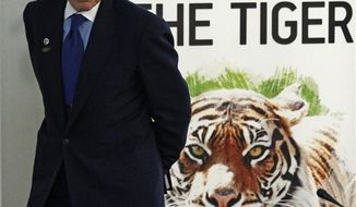 President of the World Bank, Robert B. Zoellick attends the International Tiger Forum in St.Petersburg, Russia, Tuesday, Nov. 23, 2010. Officials from the 13 countries where tigers live in the wild have signed a declaration aimed at saving the iconic big cats from extinction. (AP Photo/Dmitry Lovetsky)
