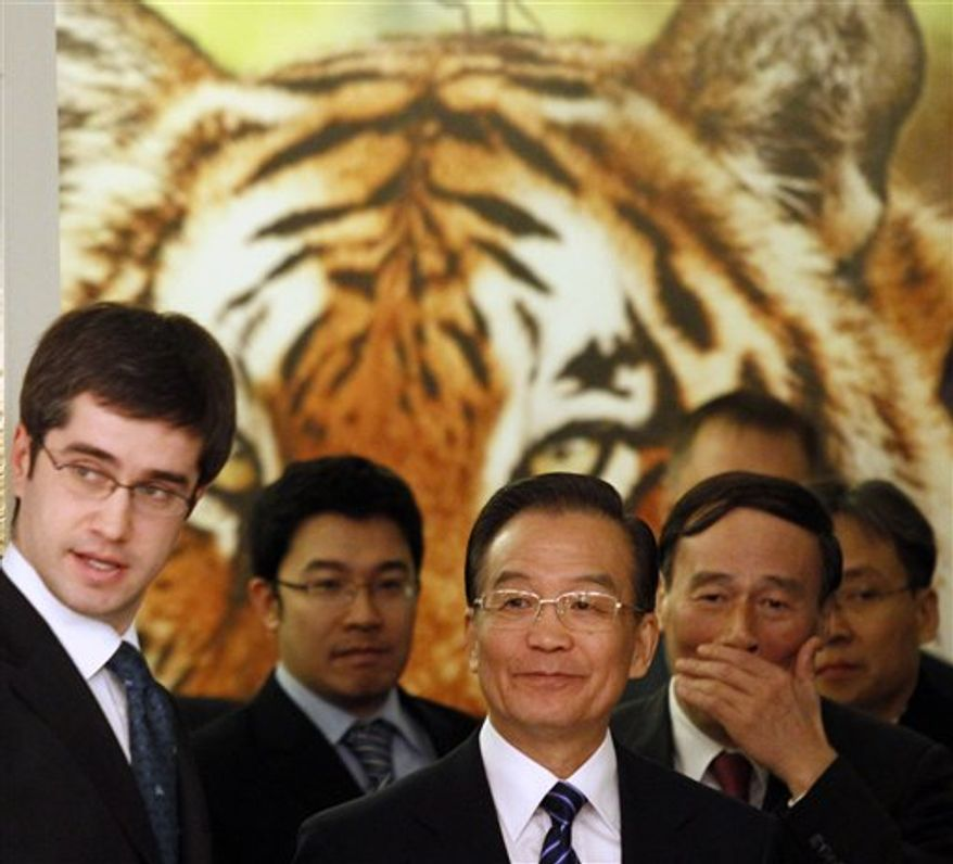 Chinese Prime Minister Wen Jiabao, center, prior to his meeting with his Russian counterpart Vladimir Putin, in St.Petersburg, Russia, Tuesday, Nov. 23, 2010. The Chinese Prime Minister will be taking part in the International Tiger Forum. Demand in China poses the greatest threat to tigers in the wild and organized crime runs the illicit trade in the world's largest felines, international experts said. (AP Photo/Dmitry Lovetsky)