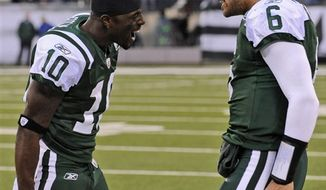 New York Jets quarterback Mark Sanchez (6) and teammate Santonio Holmes (10) celebrate after they connected for the game-winning touchdown during the fourth quarter of an NFL football game against the Houston Texans at New Meadowlands Stadium, Sunday, Nov. 21, 2010, in East Rutherford, N.J. The Jets won 30-27. (AP Photo/Bill Kostroun)